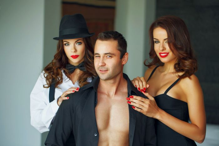 Man with two sexy ladies getting ready to have sex