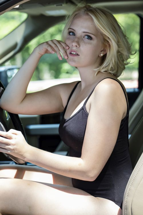blond girl anticipates the dogging session in her car