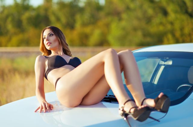 Townsville dogger woman sitting on a car