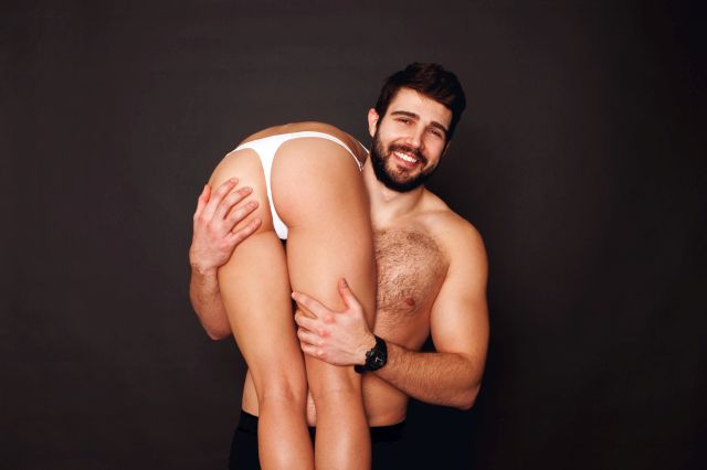 bearded man carrying a hot lady