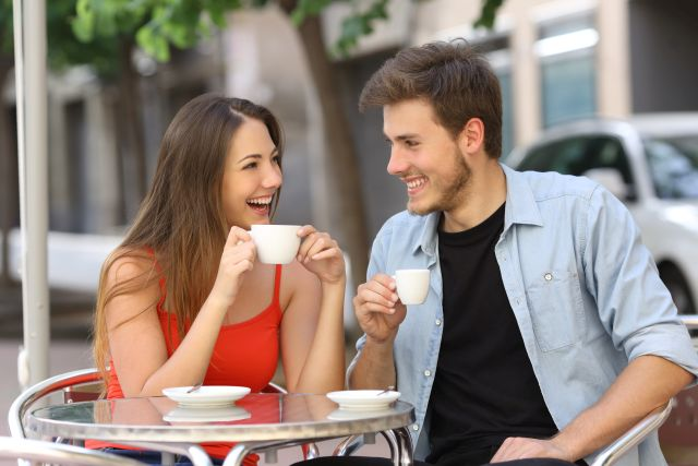 Happy couple drinking coffee in a restaurant