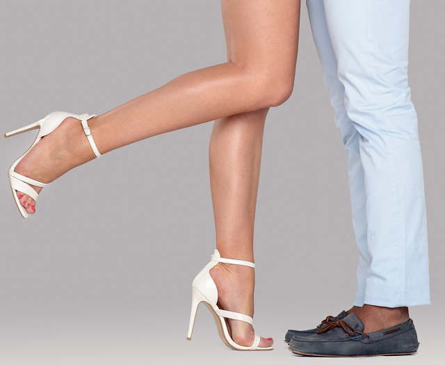 Legs of a woman with high heels and her lover