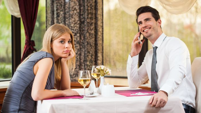 woman looking bored at her date