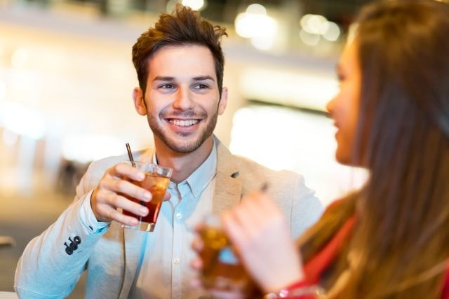 attractive man in bar avoiding breaking circle