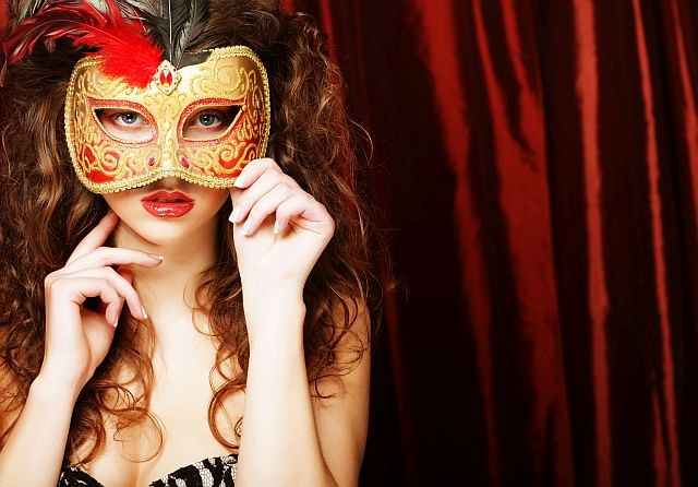 interesting brunette covering her face with a mask