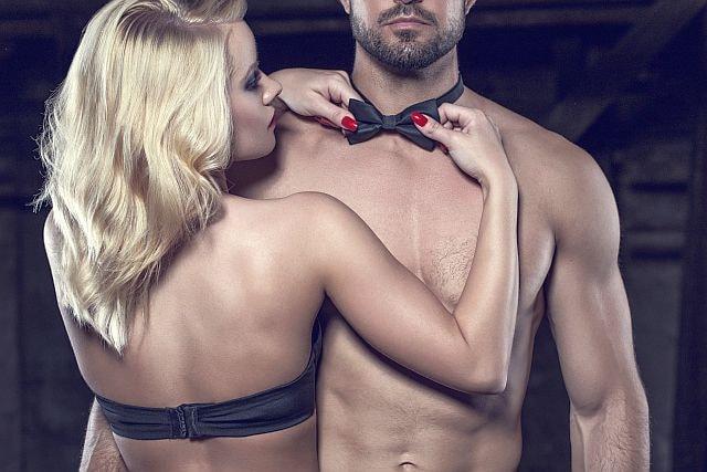 sensual blonde seducing an attractive topless man