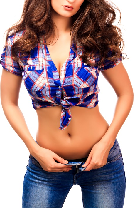 Good-looking woman in a short sexy shirt displaying her belly