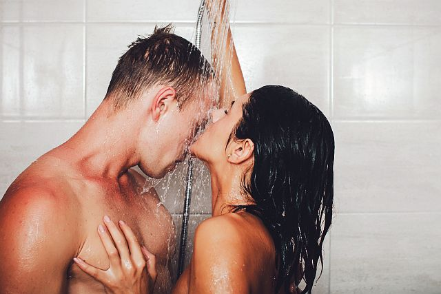 couple having incredible sex in the shower