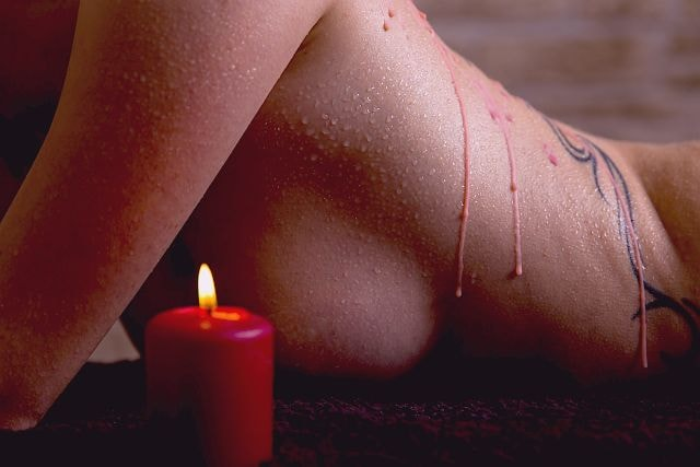 woman's body with some candle wax on her back
