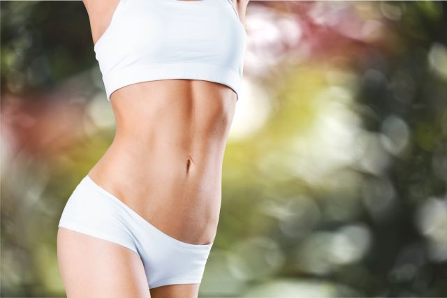 Woman with a tight body posing in white underwear