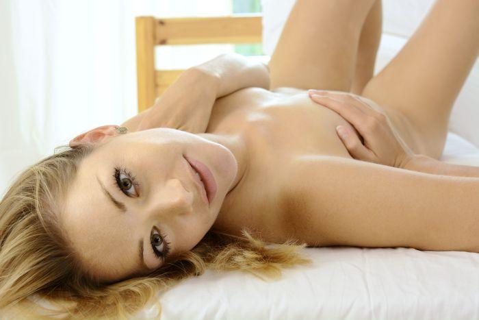 Sexy fuck buddy lying on bed