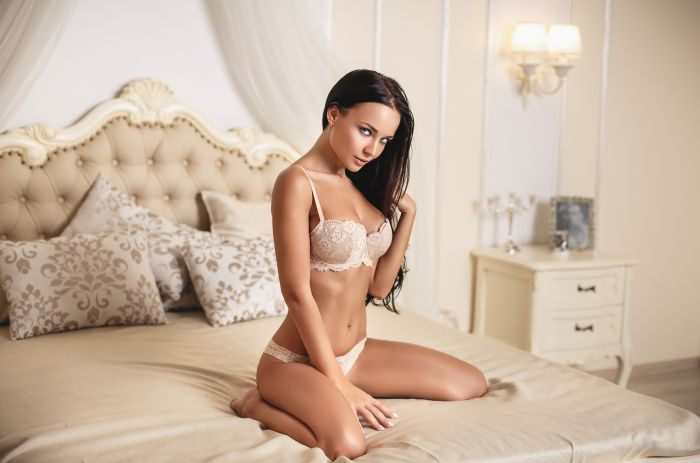 beautiful brunette in sexy white lingerie