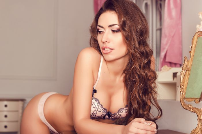 gorgeous brunette with a light pink bra and black lace