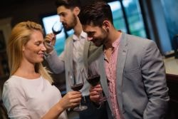 Blond cougar enjoying a glass of fine wine in Christchurch