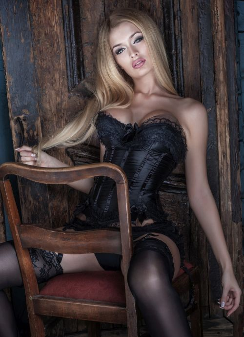 elegant Hamilton Milf with big breasts sitting provocatively on a chair