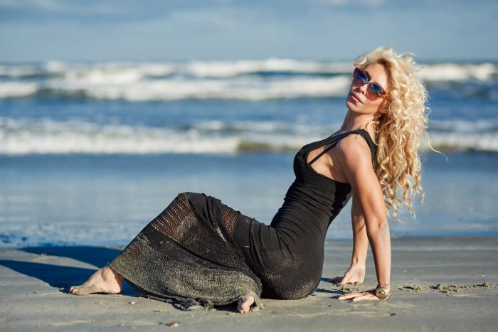 blonde milf posing on the beach