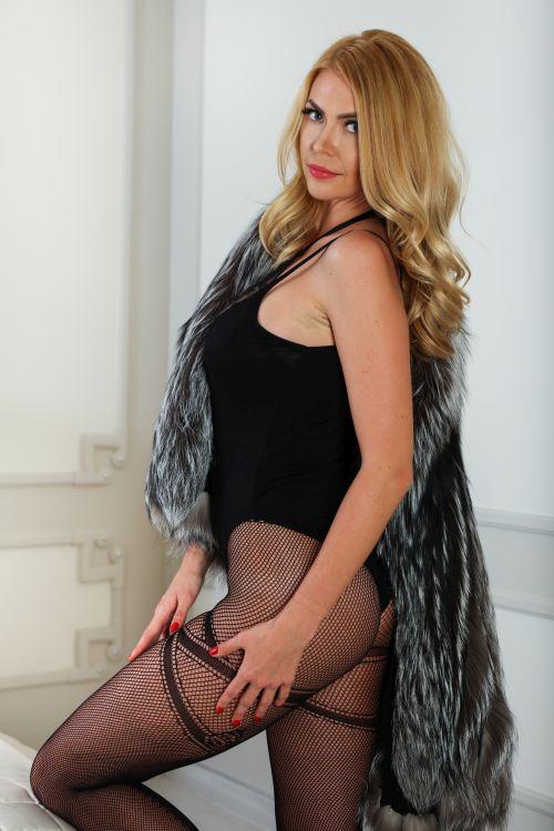 sexy blonde milf in a black body