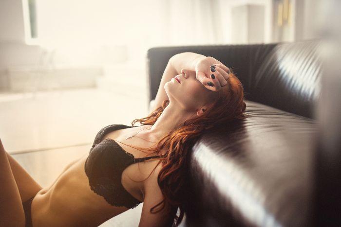 sexy redhead milf in her livingroom