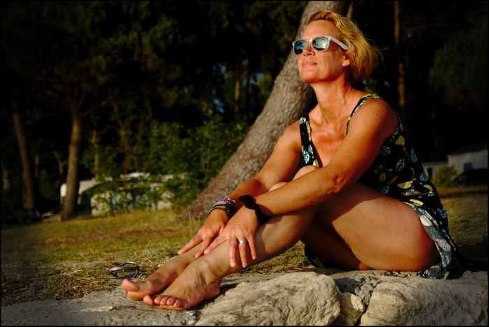 beautiful middleaged woman sunbathing