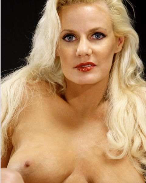Hot blond gilf showing her breasts