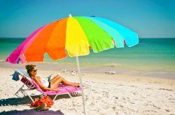 hot MILF taking the sun at the beach