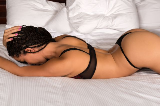 African American Milf on bed wearing black underwear