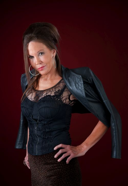 brunette milf with a leather jacket
