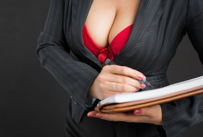 woman in business outfit showing her breasts
