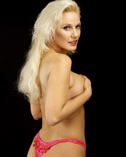 older blonde woman in pink panties