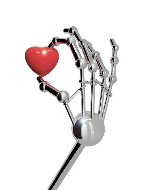 Hand eines Roboters mit Herz
