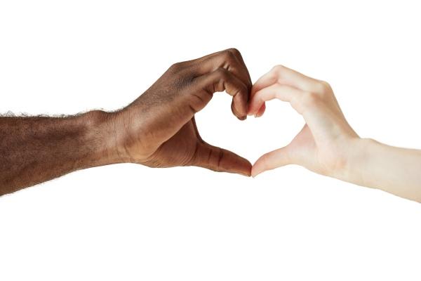 Schwarze und weiße Hand Formen ein Herz